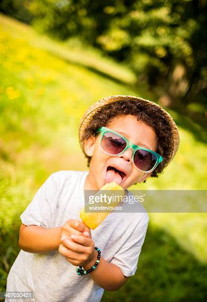 Kid licking ice cream on sunny summer day