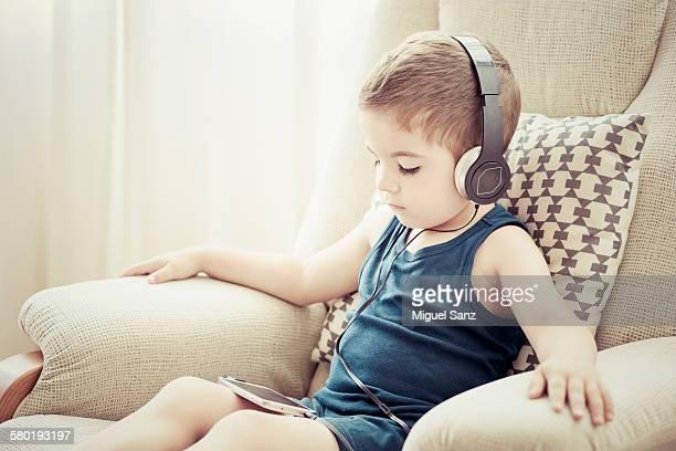 Kid listening to music with headphones