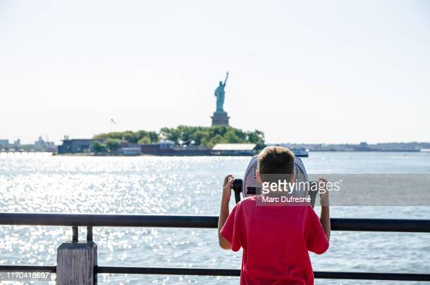 kid looking at statue of liberty - jersey city stock pictures, royalty-free photos & images
