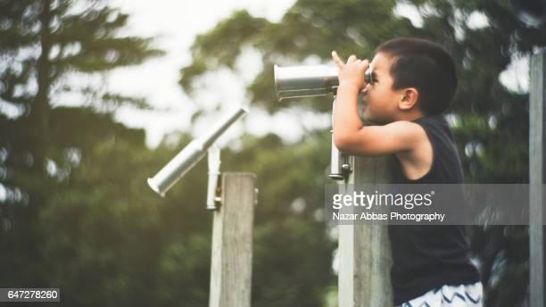 Kid Looking Through Binaculars.