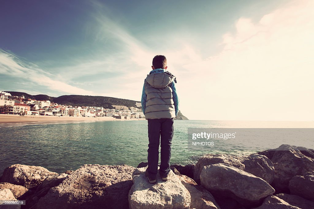 Kid looking to Sesimbra bay : Stock Photo