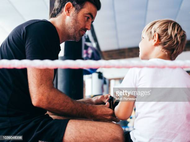 Kid looks at boxing mentor