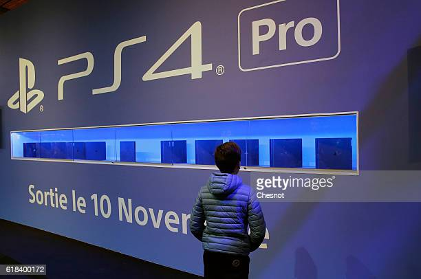 A kid looks at Sony PlayStation game consoles PS4 Pro developed by Sony Interactive Entertainment during the 'Paris Games Week'on October 26 2016 in...
