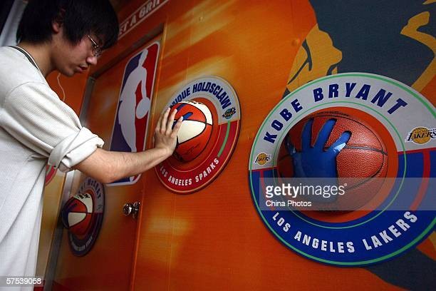 A kid measures his palm with that of a NBA star in the NBA Jam Van on May 5 2006 in Nanjing of Jiangsu Province China NBA Jam Van the NBA's premiere...