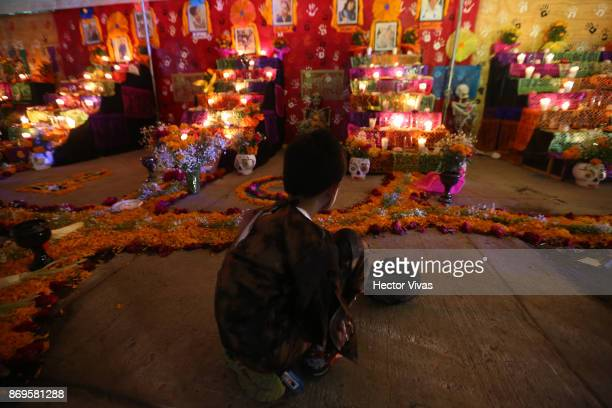 A kid observes a traditional Mexican offering placed in outside a building damaged by the September 19th earthquake In this collapsed building 9...