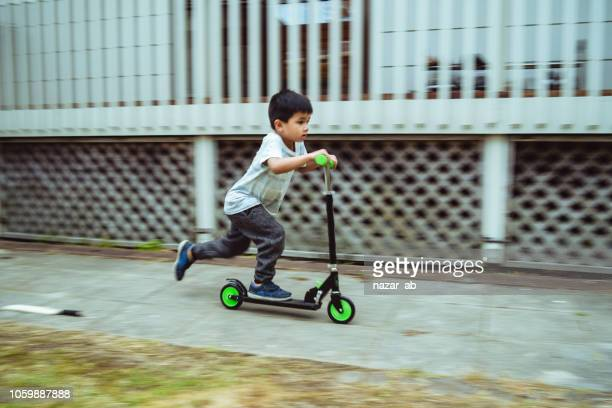 kid on push bike.