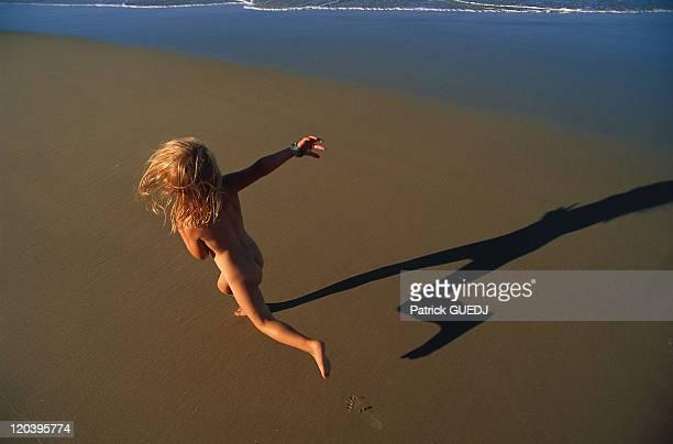 Kid on the beach in Queensland Australia Book 'Fleur de peau' p131