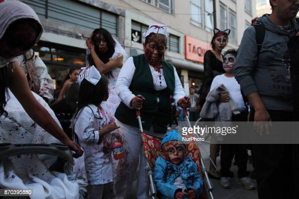 A kid painted an disgused as a baby zombie during the annual procession of zombies in Mexico City on November 4 2017 Hundreds dressed in rags and...