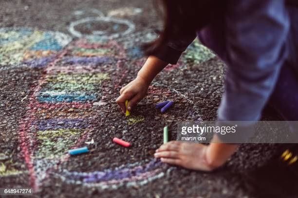 Kid painting on the ground