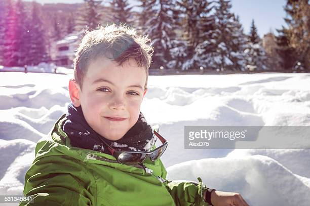 Kid Palying in the Snow