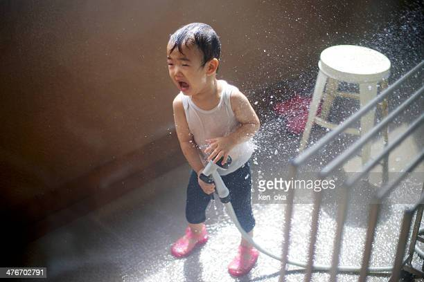 A kid play with a shower