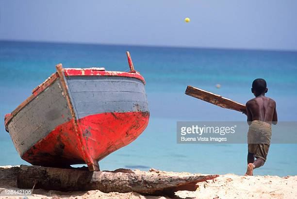 kid playing cricket, grand anse beach, st georges - beach cricket stock pictures, royalty-free photos & images