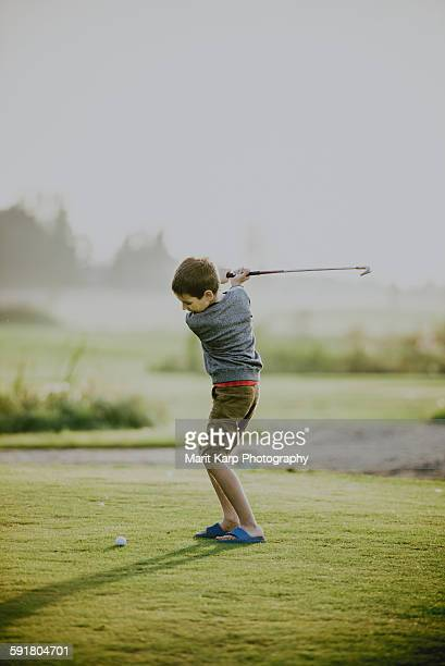 Kid playing golf