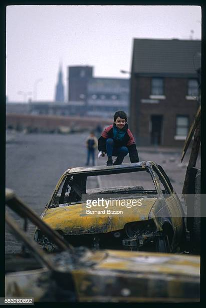 Kid Playing on a Burnt Car