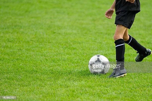 kid playing soccer - cleats stock pictures, royalty-free photos & images
