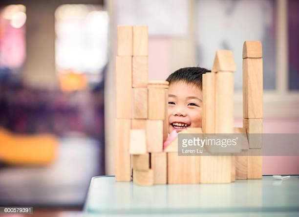 Kid playing toy building blocks