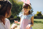 little girl wearing rabbit ear headband