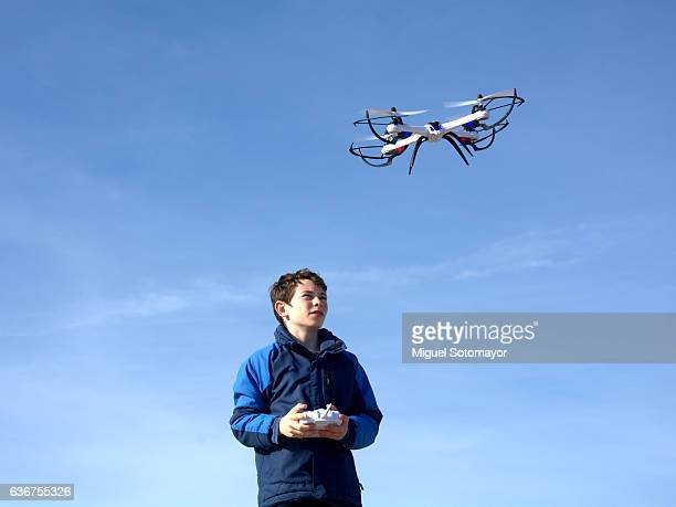 Kid playing with his drone on the drone