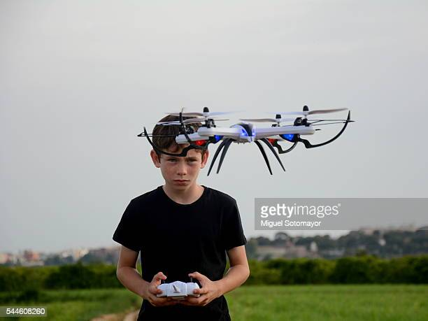 Kid playing with his drone