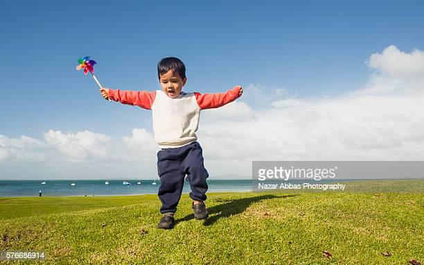 Kid playing with Paper Pinwheel.