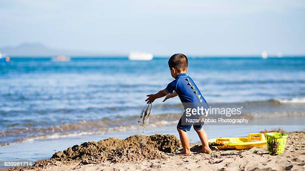 Kid Playing With Sand.