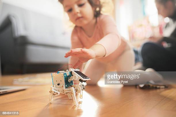 Kid playing with solar robot