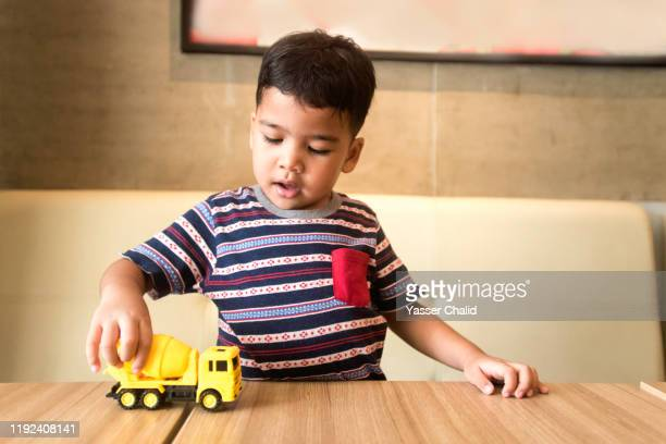 kid playing with truck toy - one boy only stock pictures, royalty-free photos & images