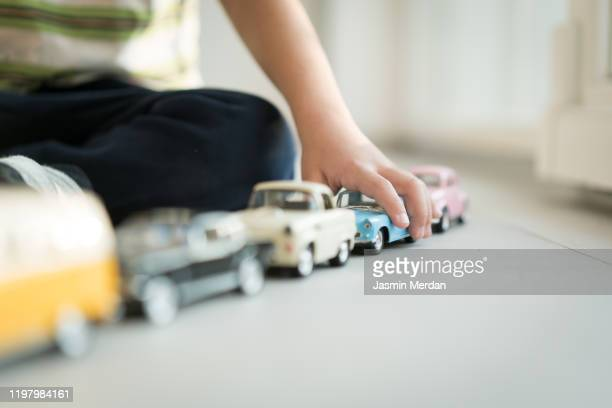 kid playing with vintage cars toys - toy car stock pictures, royalty-free photos & images