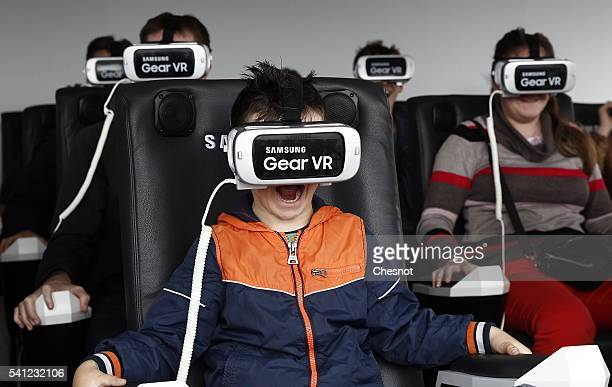 A kid plays a game with the virtual reality headmounted Samsung Gear VR powered by Oculus at 'S7 Life Changer Park' on June 19 2016 in Paris France...
