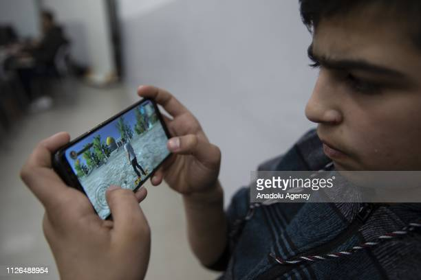 A kid plays the 'Protector of Aqsa' a game developed for younger generation to recognize AlAqsa Mosque Compound in Jerusalem on February 14 2019...