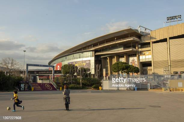 A kid plays with a soccer ball in front of Camp Nou gate in Barcelona Spain on March 15 2020 Spain said Saturday it will place the entire country...