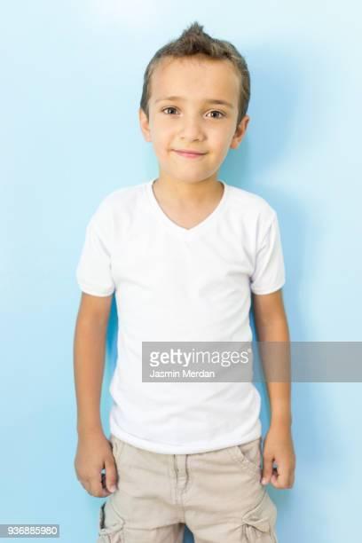 Kid portrait on blue background