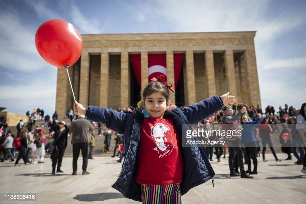 Kid poses for a photo during her visit to Anitkabir, the mausoleum of Mustafa Kemal Ataturk, the founder of the Turkish Republic during the National...
