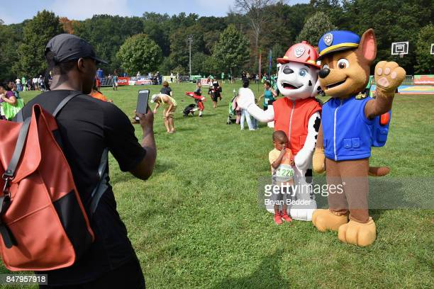 Kid poses with Paw Patrol at Nickelodeon's Worldwide Day Of Play Celebration at the Nethermead in Prospect Park on September 16, 2017 in Brooklyn,...