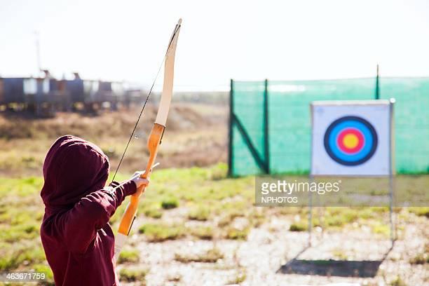 Kid praticing bow and arrow