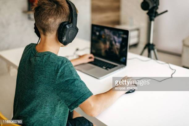 kid recording his gameplay for vlog - leisure games stock pictures, royalty-free photos & images