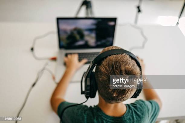 kid recording his gameplay for vlog - digital native stock pictures, royalty-free photos & images