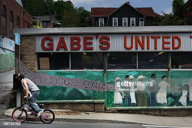 A kid rides a bike on a street on May 20 2013 in Waterbury Connecticut Waterbury once a thriving industrial city with one of the largest brass...
