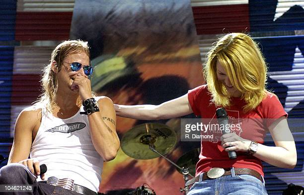 Kid Rock and Allison Moore during Farm Aid 2002 Concert and Backstage at PostGazette Pavilion in Burgettstown Pennsylvania United States