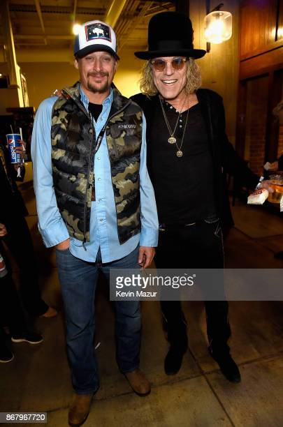 Kid Rock and Big Kenny Alphin of Big Rich attend SiriusXM presents the Eagles in their first ever concert at the Grand Ole Opry House on October 29...
