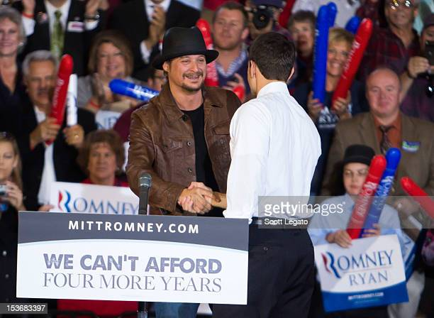 Kid Rock and Congressman Paul Ryan attends the Congressman Paul Ryan Rally With Kid Rock at Oakland University Athletic Center on October 8 2012 in...