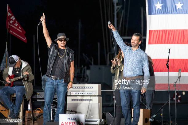 Kid Rock and Donald Trump Jr speak onstage during the Trump 2020 rally on September 14 2020 in Harrison Michigan