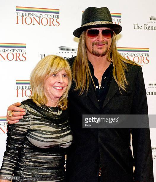 Kid Rock and his mother Susan Ritchie arrive for a dinner for Kennedy honorees hosted by US Secretary of State Hillary Rodham Clinton at the US...