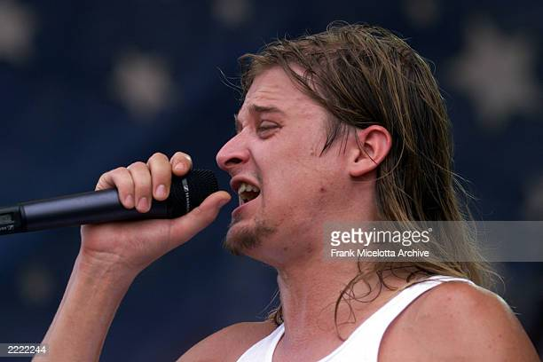 Kid Rock performs on the east stage Saturday at Woodstock '99 in Rome New York at Griffiss AFB Park for the 30th Anniversary Concert They are among...