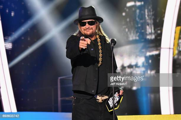Kid Rock presents an award onstage at the 2017 CMT Music Awards at the Music City Center on June 7 2017 in Nashville Tennessee