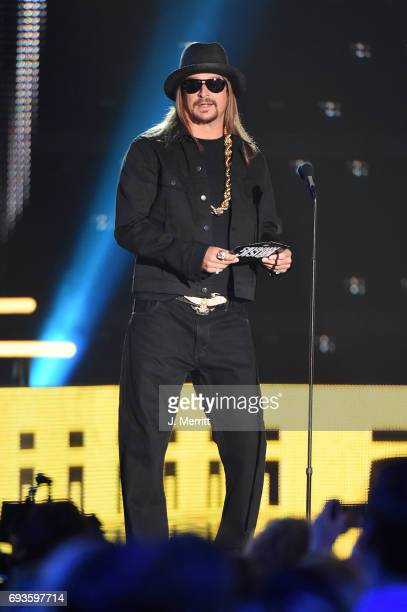 Kid Rock presents an award onstage during the 2017 CMT Music Awards at the Music City Center on June 7 2017 in Nashville Tennessee