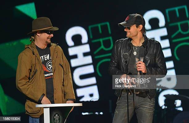 Kid Rock presents award to Eric Church onstage during the 2012 CMT Artists Of The Year at The Factory at Franklin on December 3 2012 in Franklin...