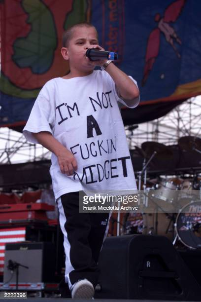 Kid Rock rapper and sideman Joe C performs on the east stage Saturday at Woodstock '99 in Rome New York at Griffiss AFB Park for the 30th Anniversary...