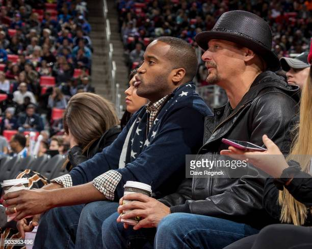 Kid Rock sits court side with John James a Republican candidate for the US Senate during the an NBA game between the Detroit Pistons and the Houston...