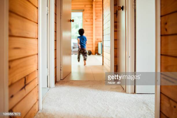 Kid running in corridor.